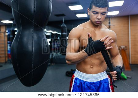 Boxer getting ready for fight in gym