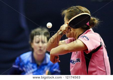 KUALA LUMPUR, MALAYSIA - SEPTEMBER 24: Kim Kyung Ah, South Korea (ITTF World Rank 10) hits a return shot at the Volkswagen 2010 Women's World Cup in table tennis on September 24, 2010 in Kuala Lumpur.