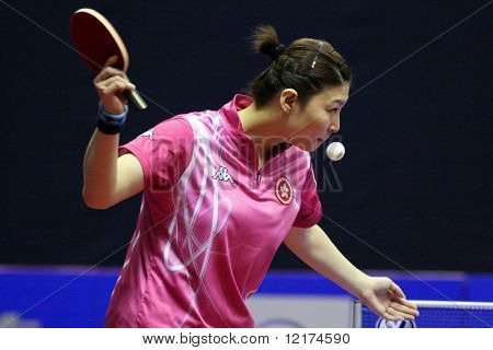 KUALA LUMPUR, MALAYSIA - SEPTEMBER 24: Jiang Huajun, Hong Kong (ITTF World Ranking #9) executes a serve at the Volkswagen 2010 Women's World Cup in table tennis on September 24, 2010 in Kuala Lumpur.