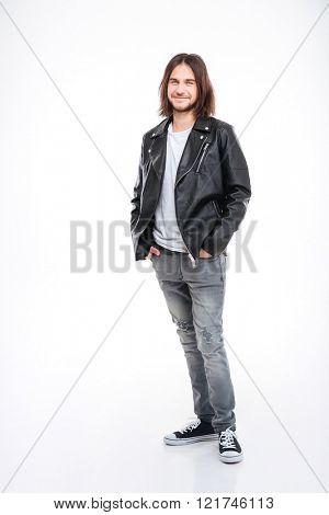 Full length portrait of attractive smiling young man with long hair in black leather jacket over white background