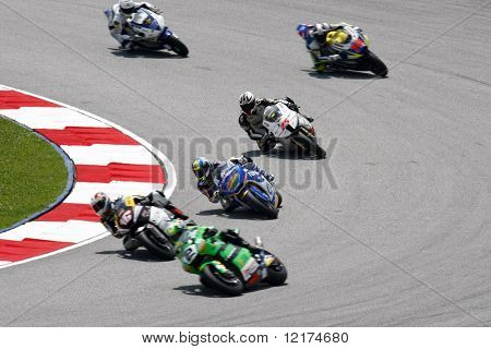 KUALA LUMPUR, MALAYSIA - OCTOBER 9: Moto2 riders race during the qualifying session of the 2010 Malaysian Motorcycle Grand Prix on October 9, 2010 at the Sepang International Circuit, Malaysia.