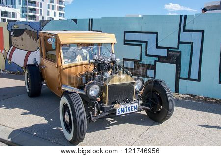 COCKBURN CENTRAL,WA,AUSTRALIA-MARCH 13,2016: Gold antique car on display at the Cockburn Central Billy Cart Festival in Cockburn Central, Western Australia.