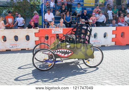 COCKBURN CENTRAL,WA,AUSTRALIA-MARCH 13,2016: Billy cart with shark design and driver racing at the Cockburn Central Billy Cart Festival in Cockburn Central, Western Australia.