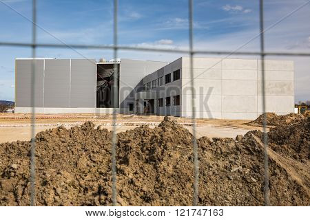 Construction site with a fence around it