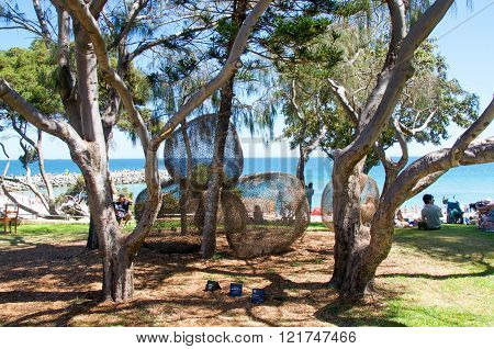 COTTESLOE,WA,AUSTRALIA-MARCH 12,2016: Sea through spherical sculptures and tourists at the