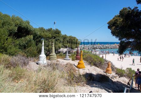COTTESLOE,WA,AUSTRALIA-MARCH 12,2016: Colourful multiple piece sculpture display overlooking the tourists at the