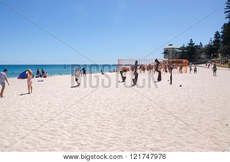 COTTESLOE,WA,AUSTRALIA-MARCH 12,2016: Crowds at Cottesloe Beach with interactive sculptures at the