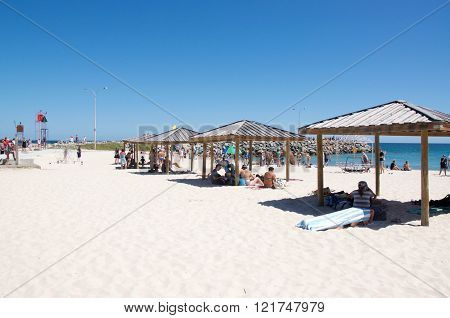 COTTESLOE,WA,AUSTRALIA-MARCH 12,2016: Shade its and sculptures with tourists at the