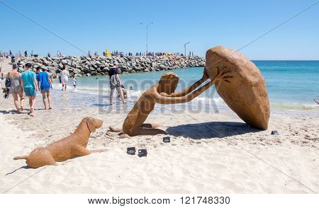 COTTESLOE,WA,AUSTRALIA-MARCH 12,2016:  Human figure and dog sculpture with people at the interactive free public arts festival
