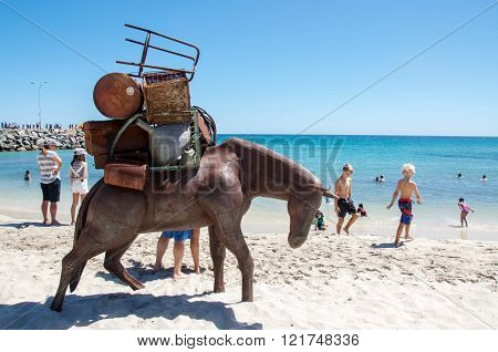 COTTESLOE,WA,AUSTRALIA-MARCH 12,2016:  Travelling horse metal sculpture with spectators at the interactive free public arts festival