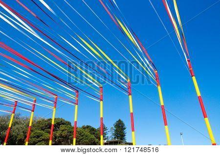 COTTESLOE,WA,AUSTRALIA-MARCH 12,2016:  Ribbon and pole sculpture detail at the public arts festival