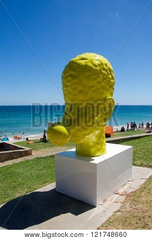 COTTESLOE,WA,AUSTRALIA-MARCH 12,2016:  Yellow blowing bubble sculpture at the public arts festival