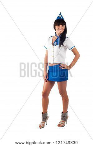 Young beautiful air hostess smiles