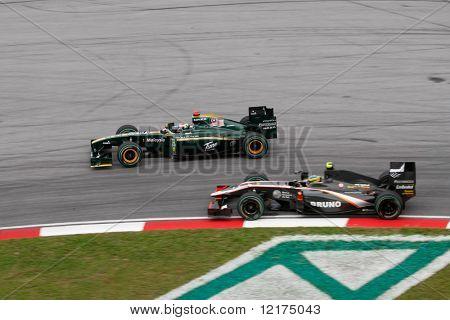 KUALA LUMPUR - APRIL 4: Jarno Trulli of the Lotus team (left) leads Bruno Senna of the HRT F1 team on race day at the 2010 Petronas Malaysia GP on April 4, 2010 in Sepang International Circuit.