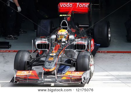 KUALA LUMPUR - APRIL 2: McLaren's driver Lewis Hamilton exits the garage for his practice lap on practice day at the 2010 Petronas Malaysia F1 Grand-Prix on April 2, 2010 in Sepang, Malaysia.