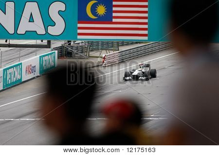 KUALA LUMPUR - APRIL 2: BMW Sauber's Pedro de la Rossa drives by under the watchful eyes of the spectators on practice day at the 2010 Petronas Malaysia F1 Grand-Prix on April 2, 2010 in Malaysia.