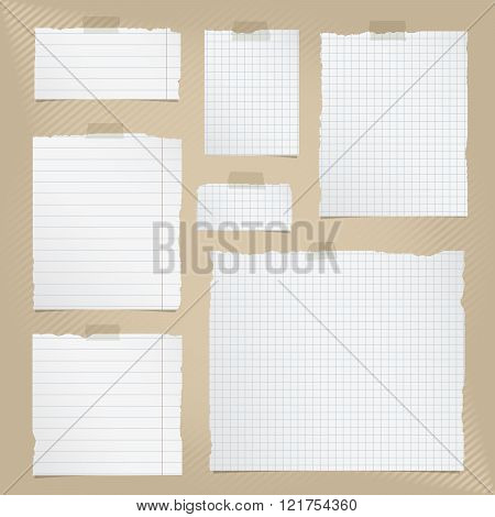 Pieces of torn white squared and lined notebook paper with sticky tape on brown striped background