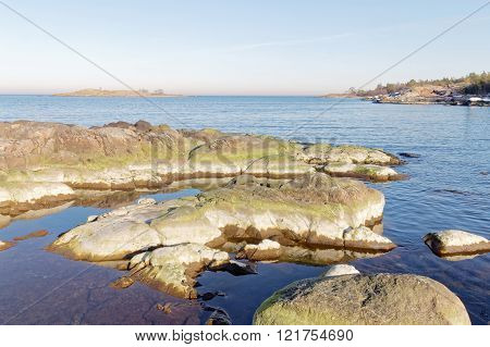 Archipelago, sea and rocks covered with green algae a sunny morning in spring in Sweden