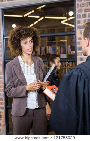 Lawyer interacting with businesswoman in office