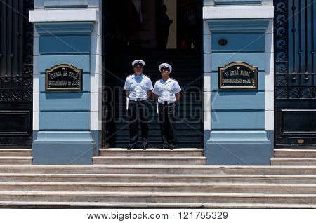 Valparaiso Chile - December 3 2012: Unidentified Sailors from the Chilean Navy stand in front of the Chilean Navy building on December 3 2012 in Valparaiso Chile.