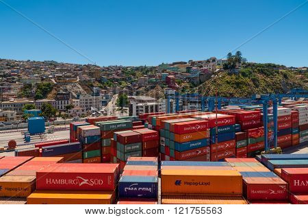 Valparaiso, Chile - December 3, 2012: View to the cargo sea port and residential area of Valparaiso city on December 3, 2012 in Valparaiso, Chile. Valparaiso sea port is the busiest one in Chile.