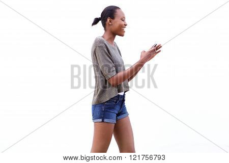 Happy Young African Woman Walking And Using Mobile Phone