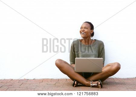 Happy African American Woman Sitting With Laptop