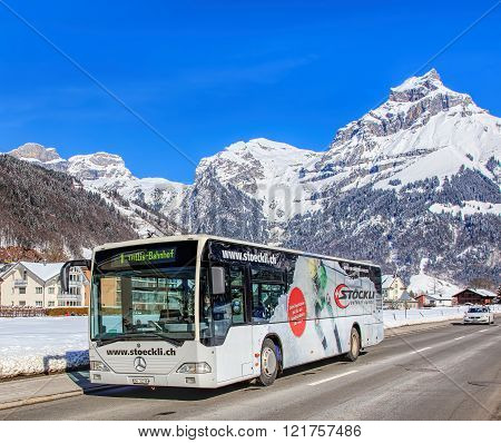 Bus On The Elgelbergerstrasse Street In Engelberg, Switzerland