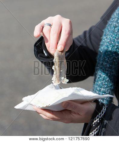 Dutch Woman Is Eating Typical Raw Herring