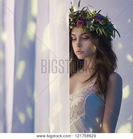 Fashion art photo of beautiful lady in flower diadem. Spring/Summer