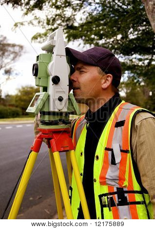 Surveyor taking measurements