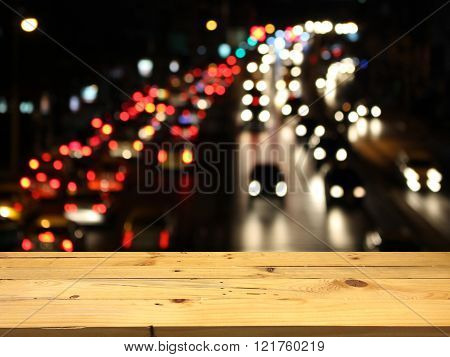 Wood Table For Product Placement, Blurred Traffic Jam