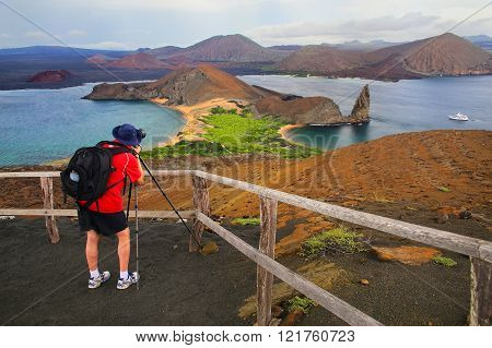 GALAPAGOS, ECUADOR - APRIL 20: Unidentified man photographes on April 20, 2015 on Bartolome island in Galapagos National Park, Ecuador. This park is a UNESCO World Heritage Site