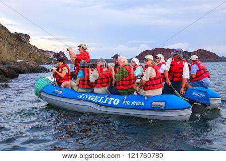 GALAPAGOS, ECUADOR - APRIL 20: Unidentified people photograph from dinghy on April 20, 2015 near Bartolome island in Galapagos National Park, Ecuador. This park is a UNESCO World Heritage Site