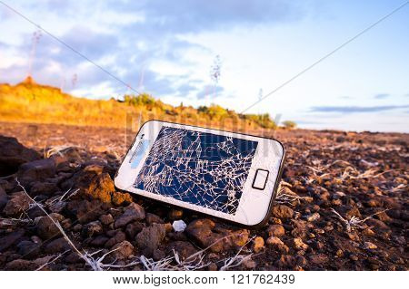White Smartphone with Broken Display