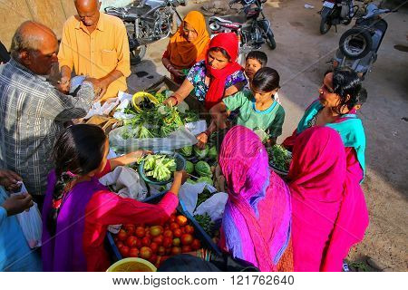 JAIPUR, INDIA - NOVEMBER 15: Unidentified people shop for vegetables at the street market on November 15, 2014 in Jaipur, India. Jaipur is the capital and the largest city of Rajasthan.