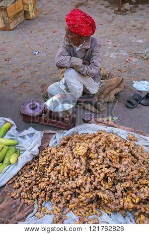 Jaipur, India - November 15: Unidentified Man Sells Ginger At The Street Market On November 15, 2014