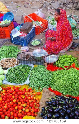 JAIPUR, INDIA - NOVEMBER 15: Unidentified woman sells vegetables at the street market on November 15, 2014 in Jaipur, India. Jaipur is the capital and the biggest city of the Indian state of Rajasthan