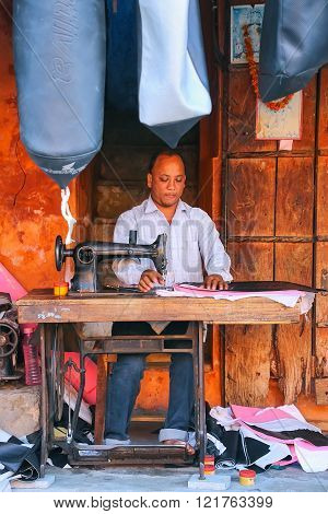 Jaipur, India - November 15: Unidentified Man Makes Motobike Seat Covers At Johari Bazaar Street On