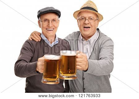 Two senior gentlemen making a toast with beer and looking at the camera isolated on white background