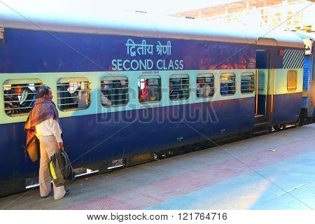 JAIPUR, INDIA - NOVEMBER 15: Unidentified man stands at Jaipur Junction Railway Station on November 15, 2014 in Jaipur, India. Jaipur station alone deals with 35,000 passengers in a day.