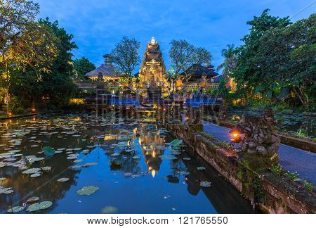 Pura Saraswati Temple with beatiful lotus pond at dusk before the dancing show Ubud Bali Indonesia