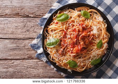 Amatriciana Spaghetti With Cheese And Basil On A Plate. Horizontal Top View
