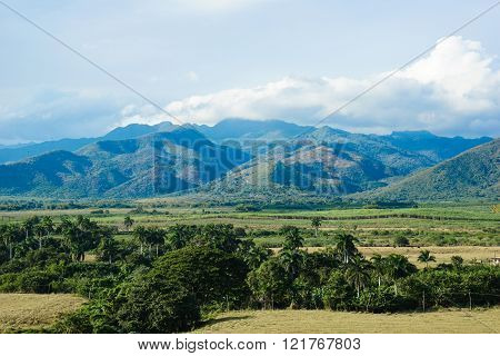 View Of Landscape With Mountains And Clear Blue Sky