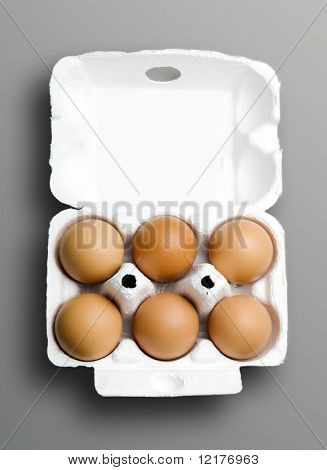 Half dozen fresh eggs in box made of recycled paper