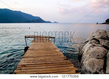 The Wooden Platform Stretching Into The Sea.