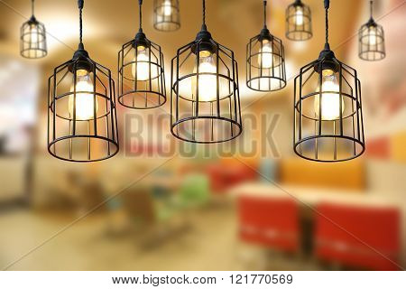 Warm lighting modern ceiling lamps in the cafe and interior decoration restaurant.