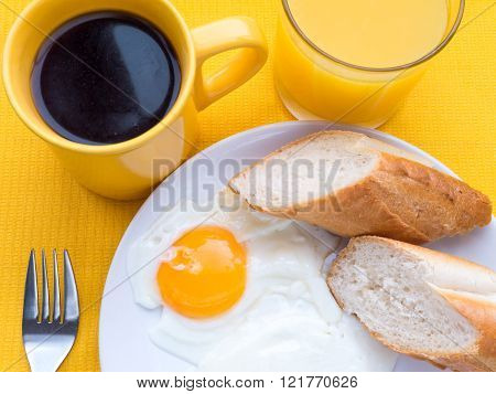 Fried Eggs, Coffee And Orange Juice Breakfast