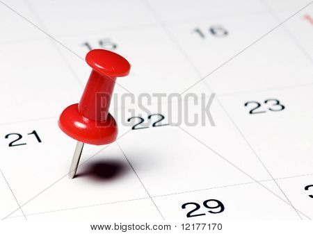 Red Thumb Tack on Calendar Page