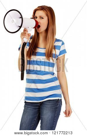 Teenage woman screaming through megaphone